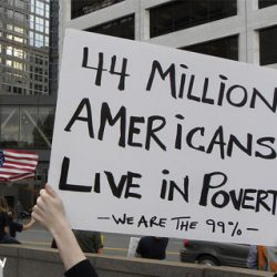 During Occupy protest, a sign with message that 44 Million Americans Live in Poverty.